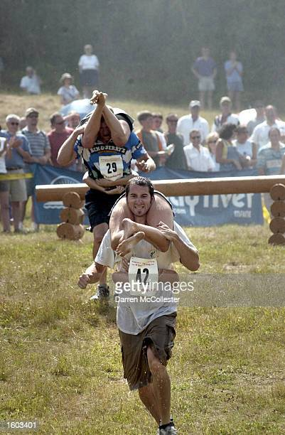 Michael Toohey carries his partner Nikkie Freese to victory during the 2nd annual North American Wife Carrying Championships July 21 2001 in Newry ME...