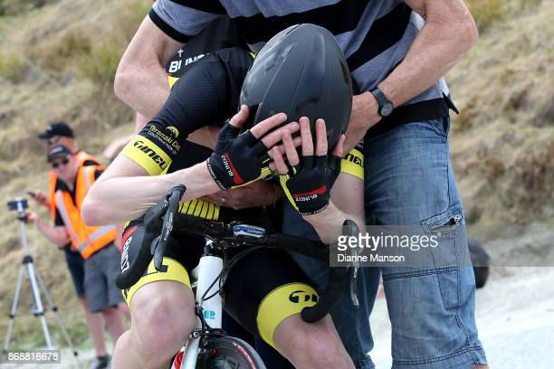 Michael Torckler of New Plymouth Blindz Direct shows his exhaustion while supported by his parents Linda and Brohn after finishing first of stage 3...