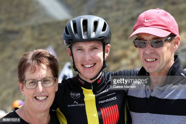 Michael Torckler of New Plymouth Blindz Direct with his parents Linda and Brohn celebrates finishing first of stage 3 from Mossburn to Coronet Peak...