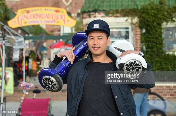 Michael Tran poses with his hoverboard on the Venice Beach Boardwalk California on December 10 2015 The hot item on many holiday lists will help you...