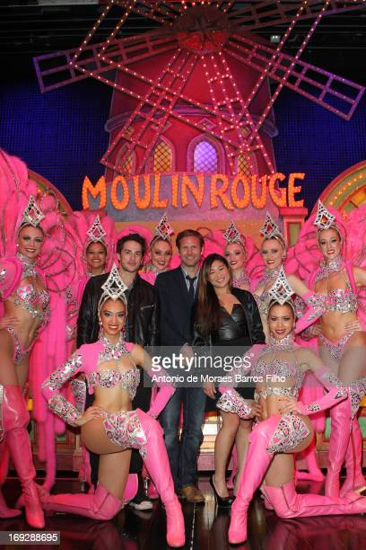 Michael Trevino Matthew Davis and Jenna Ushkowitz pose backstage with the dancers of the Moulin Rouge after they have attended the show at Le Moulin...