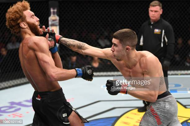 Michael Trizano punches Luis Pena in their lightweight bout during the UFC Fight Night event inside Pepsi Center on November 10, 2018 in Denver,...
