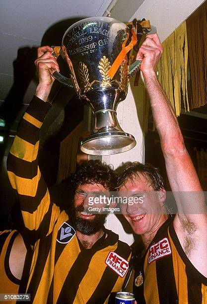 Michael Tuck and Peter Curran of the Hawks holds aloft the premiership trophy after winning the 1989 AFL Grand Final played between the Hawthorn...
