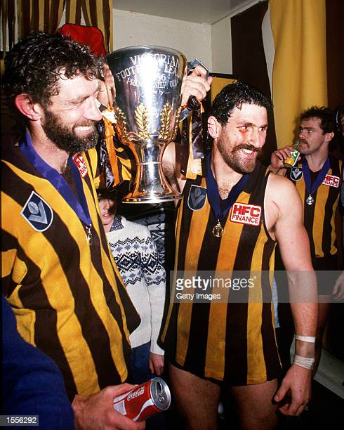 Michael Tuck and Robert Dipierdomenico of Hawthorn celebrate their win in the rooms with the Premiership Cup in the VFL Grand Final match between...