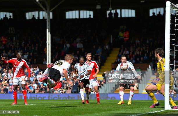 Michael Turner of Fulham FC scores Fulham's first goal during the Sky Bet Championship match between Fulham and Middlesbrough at Craven Cottage on...