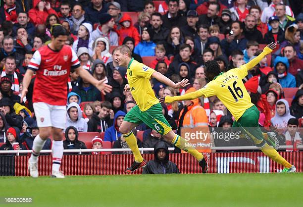 Michael Turner of Norwich City celebrates scoring the first goal of the match with teammate Kei Kamara during the Barclays Premier League match...