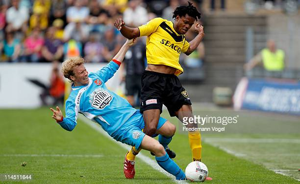 Michael Uchedo of Venlo and Ricky Kruys of Volendam battle for the ball during the Dutch Eredivise Play Off match between VVV Venlo and FC Volendam...