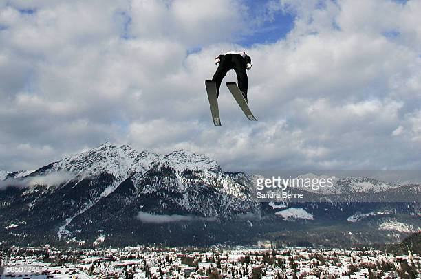 Michael Uhrmann of Germany soars through the air during training for the FIS Ski Jumping World Cup event at the 54th Four Hills ski jumping...