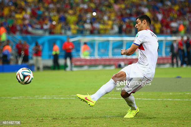 Michael Umana of Costa Rica shoots and scores a penalty kick to defeat Greece in a shootout during the 2014 FIFA World Cup Brazil Round of 16 match...