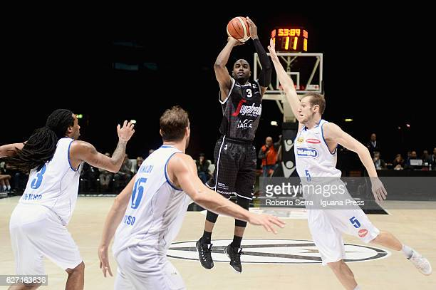 Michael Umeh of Segafredo competes with Jesse Perry and Tommaso Rinaldi and Andrea La Torre of De Longhi during the LegaBasket Serie A2 LNP match...