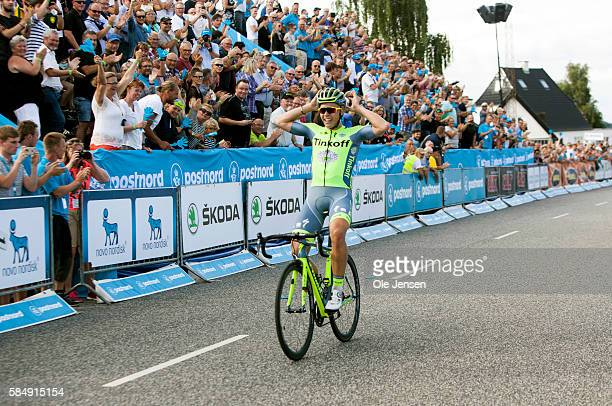 Michael Valgren from Denmark riding for team Tinkoff celebrates as he crosses the finish line on the third stage of PostNord Tour of Denmark between...