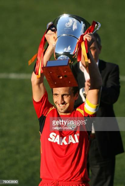 Michael Valkanis holds aloft the trophy after winning the ALeague PreSeason Cup Final match between Adelaide United and the Perth Glory at Hindmarsh...