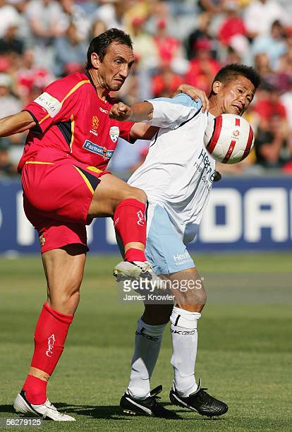 Michael Valkanis of United and Kazuyoshi Miura of Sydney in action during the round 14 ALeague match between Adelaide United and Sydney FC at...