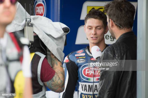 Michael Van Der Mark of Netherlands and PATA Yamaha Official WorldSBK Team speaks with journalist in box during the FIM Superbike World Championship...