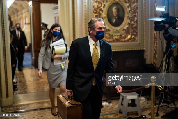 Michael van der Veen, former President Donald Trump's defense lawyer, walks from the Senate floor through the Senate Reception room on the fourth day...