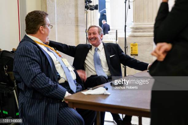 Michael van der Veen , former President Donald Trump's defense lawyer, reacts with a colleague following the conclusion of the second impeachment...