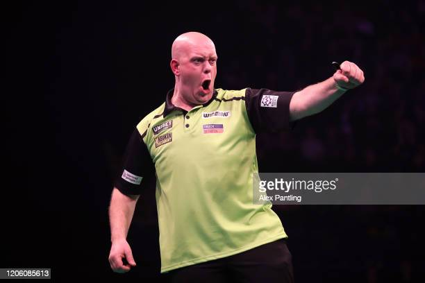 Michael Van Gerwen celebrates during his match against Daryl Gurney during day two of the Unibet Premier League at Motorpoint Arena on February 13...