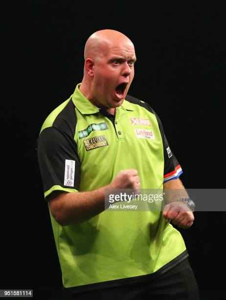 Michael van Gerwen celebrates during his match against Michael Smith in the 2018 Unibet Premier League at The Manchester Arena on April 26 2018 in...