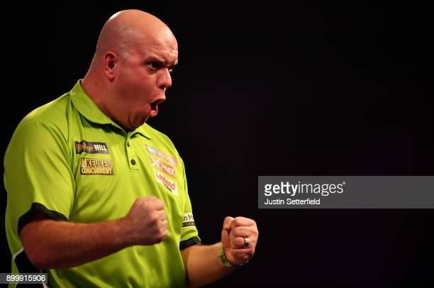 Michael van Gerwen celebrates during his Semi Final Match against Rob Cross during the 2018 William Hill PDC World Darts Championships at Alexandra...