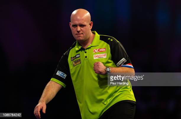 Michael van Gerwen celebrates during his third round match against Max Hopp during Day 10 of the 2019 William Hill World Darts Championship at...