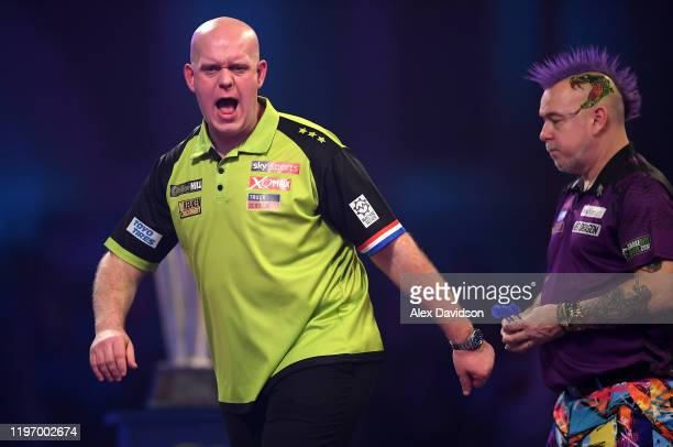 Michael van Gerwen celebrates during the Final of the 2020 William Hill World Darts Championship between Peter Wright and Michael van Gerwen at...