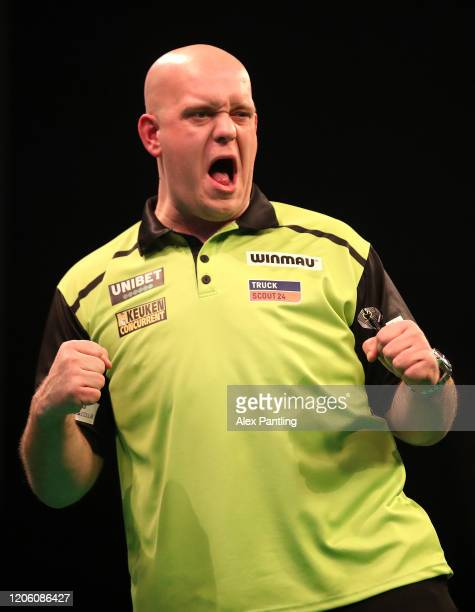 Michael Van Gerwen celebrates victory during his match against Daryl Gurney during day two of the Unibet Premier League at Motorpoint Arena on...