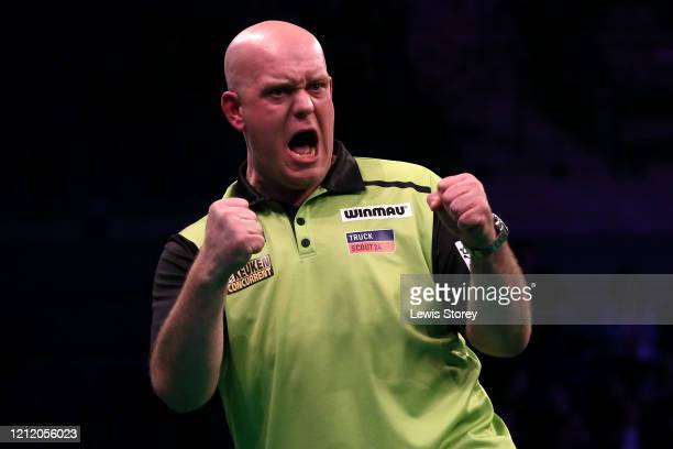 Michael van Gerwen celebrates victory in his match against Gerwyn Price during Night Six of the Premier League Darts at the MS Bank Arena on March 12...