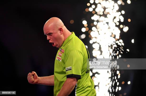 Michael Van Gerwen celebrates winning his Quarter Final Match against Raymond Van Barneveld during the 2018 William Hill PDC World Darts...