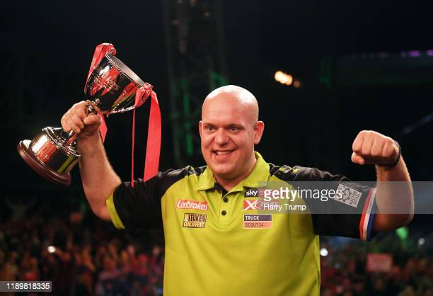 Michael Van Gerwen celebrates with the trophy after winning the PDC Players Darts Championship Final during Day Three of the PDC Players Darts...
