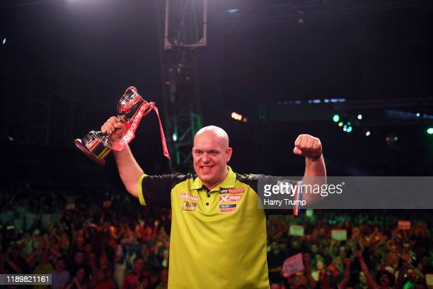 Michael Van Gerwen celebrates with the trophy and the crowd after winning the PDC Players Darts Championship Final during Day Three of the PDC...