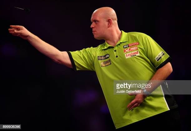 Michael van Gerwen in action during his Semi Final Match against Rob Cross during the 2018 William Hill PDC World Darts Championships at Alexandra...