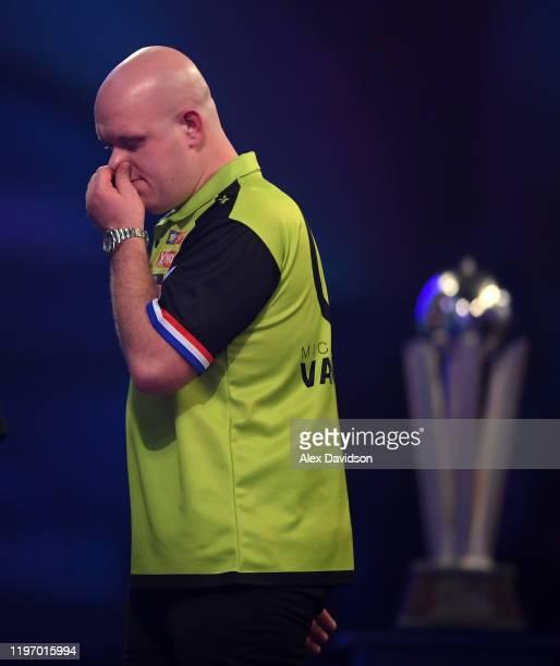 Michael Van Gerwen looks dejected during the Final of the 2020 William Hill World Darts Championship between Peter Wright and Michael Van Gerwen at...