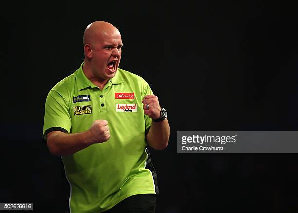 Michael van Gerwen of Holland celebrates winning a leg during his second round match against Darren Webster of England during the 2016 William Hill...