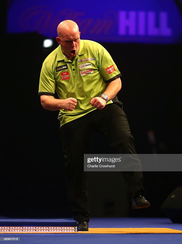 Michael van Gerwen of Holland celebrates winning his first round match against Joe Cullen of England during the William Hill PDC World Darts Championships on Day One at Alexandra Palace on December 18, 2014 in London, England.