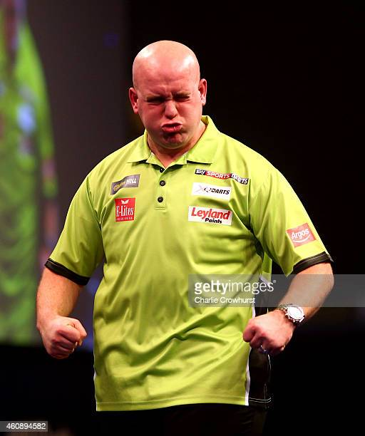 Michael van Gerwen of Holland celebrates winning his third round match against Terry Jenkins of England during the William Hill PDC World Darts...