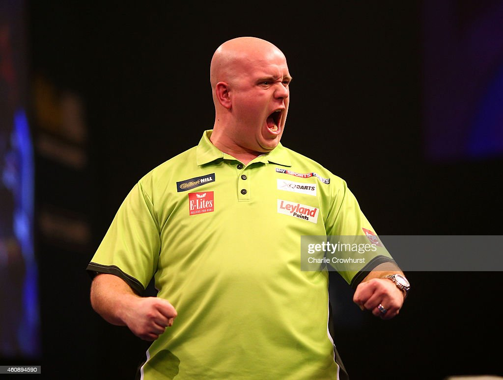 Michael van Gerwen of Holland celebrates winning his third round match against Terry Jenkins of England during the William Hill PDC World Darts Championships on Day Nine at Alexandra Palace on December 29, 2014 in London, England.