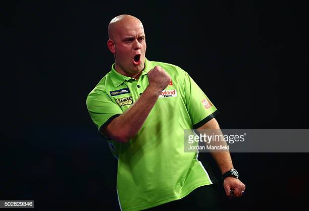 Michael van Gerwen of Holland celebrates winning the first set in his third round match against Raymond van Barneveld of Holland on Day Eleven of the...