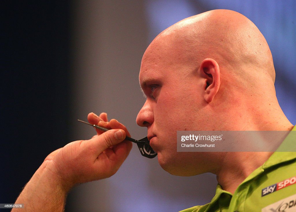 Michael van Gerwen of Holland in action during his first round match against Joe Cullen of England during the William Hill PDC World Darts Championships on Day One at Alexandra Palace on December 18, 2014 in London, England.