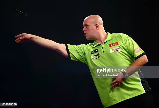 Michael van Gerwen of Holland in action in his third round match against Raymond van Barneveld of Holland on Day Eleven of the 2016 William Hill PDC...