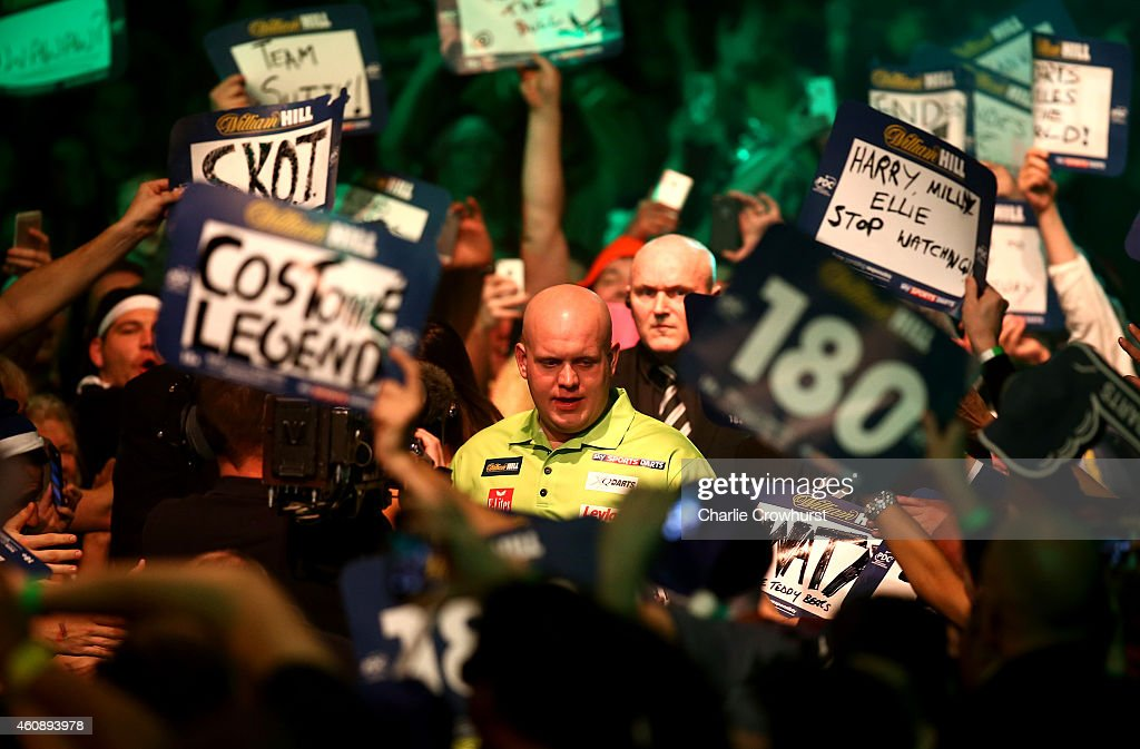 Michael van Gerwen of Holland makes his entrance during his third round match against Terry Jenkins of England during the William Hill PDC World Darts Championships on Day Nine at Alexandra Palace on December 29, 2014 in London, England.