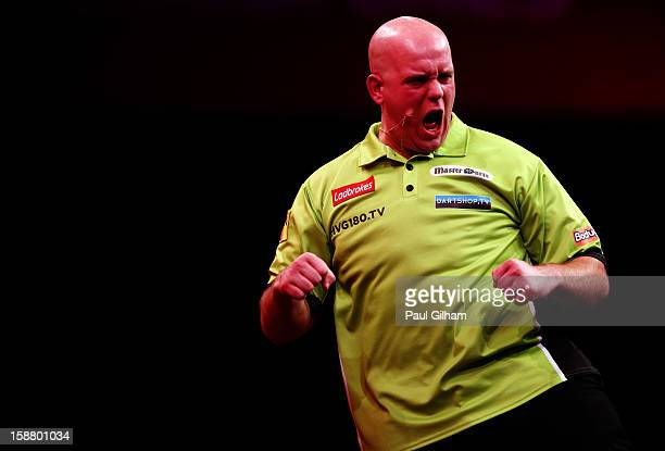 Michael van Gerwen of Netherlands celebrates winning a set during the quarter final match between Adrian Lewis of England and Michael Van Gerwen of...