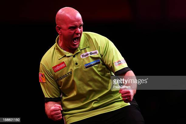 Michael van Gerwen of Netherlands celebrates winning the quarter final match between Adrian Lewis of England and Michael Van Gerwen of Netherlands on...