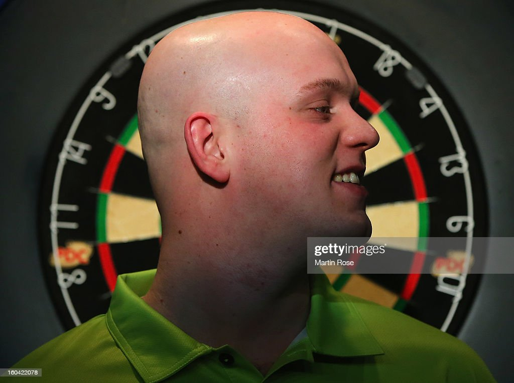 Michael van Gerwen of Netherlands looks on during a dart show tournament at between team Netherlands and Hamburger SV at Imtech Arena on January 31, 2013 in Hamburg, Germany.
