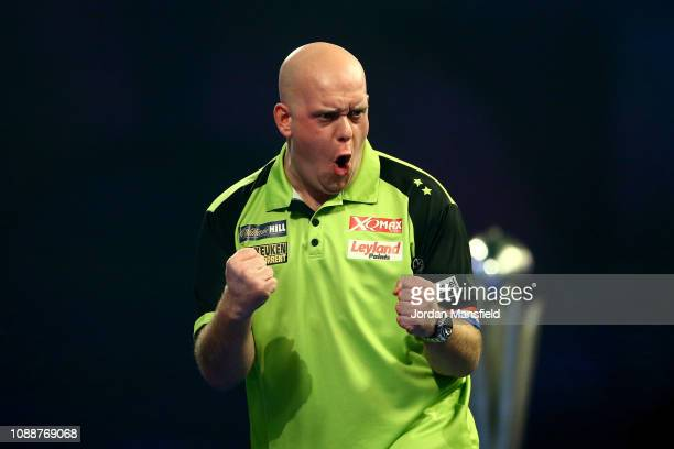 Michael van Gerwen of the Netherlands celebrates a leg during the Final match against Michael Smith of England during Day 17 of the 2019 William Hill...