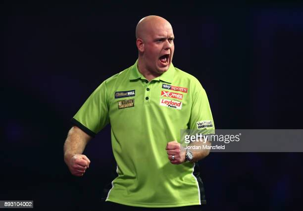 Michael van Gerwen of the Netherlands celebrates a set during his first round match against Christian Kist of the Netherlands during day one of the...