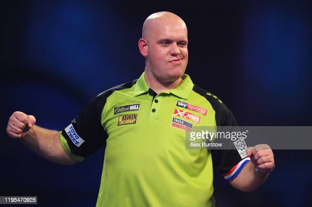 Michael van Gerwen of The Netherlands celebrates after winning his Third Round Match against Ricky Evans of England during Day Ten of the 2020...