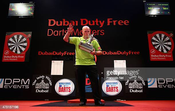 Michael Van Gerwen of the Netherlands celebrates after winning the 2015 Dubai Duty Free Darts Masters at Dubai Duty Free Tennis Stadium on May 29...