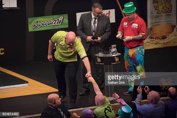 Michael van Gerwen of the Netherlands celebrates after winning the semifinal match against Peter Wright of Scotland during the SINGHA Beer Grand Slam...