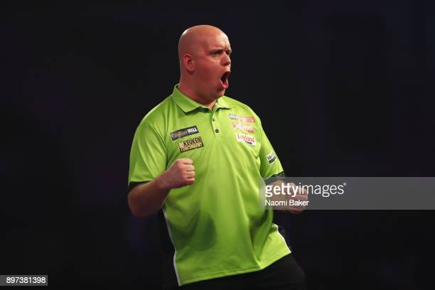 Michael van Gerwen of the Netherlands celebrates after winning the first leg during the second round match against James Wilson of England on day...