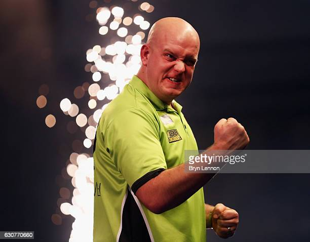 Michael van Gerwen of The Netherlands celebrates beating Raymond van Barneveld of The Netherlands in their semifinal on day fourteen of the 2017...